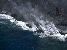 Hawaii Volcanoes National Park, lava flow into ocean from helicopter